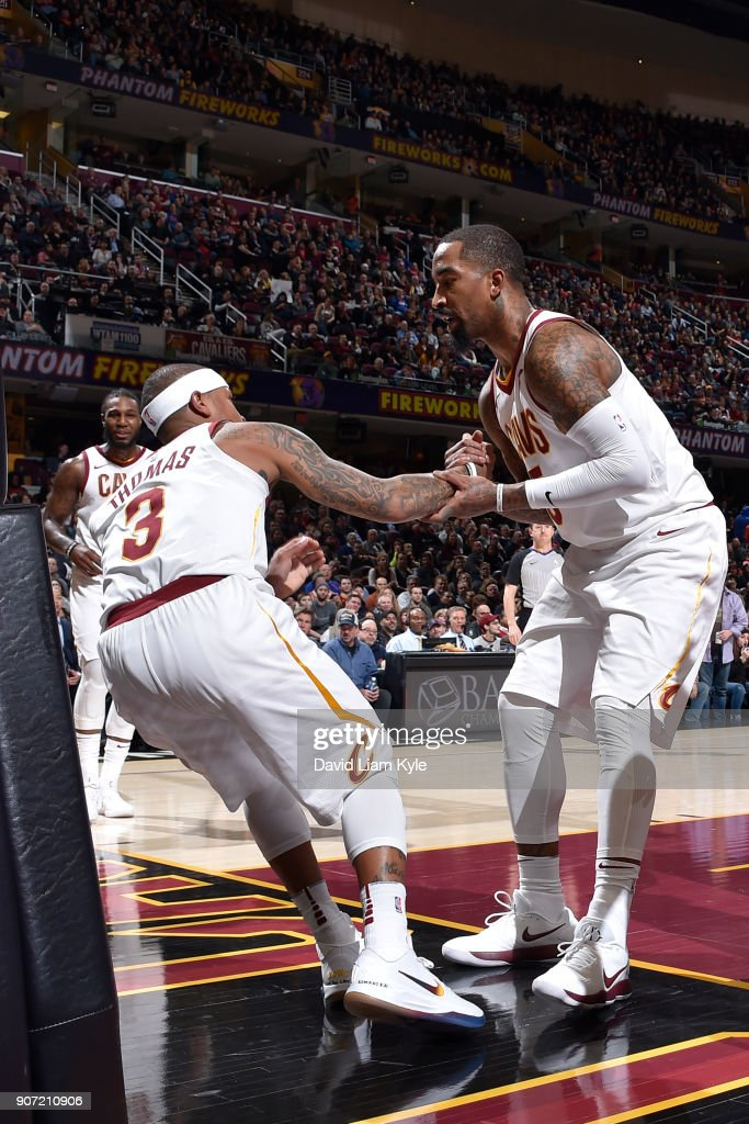 JR Smith #5 of the Cleveland Cavaliers helps Isaiah Thomas #3 of the Cleveland Cavaliers off of the floor during the game against the Orlando Magic on January 18, 2018 at Quicken Loans Arena in Cleveland, Ohio.