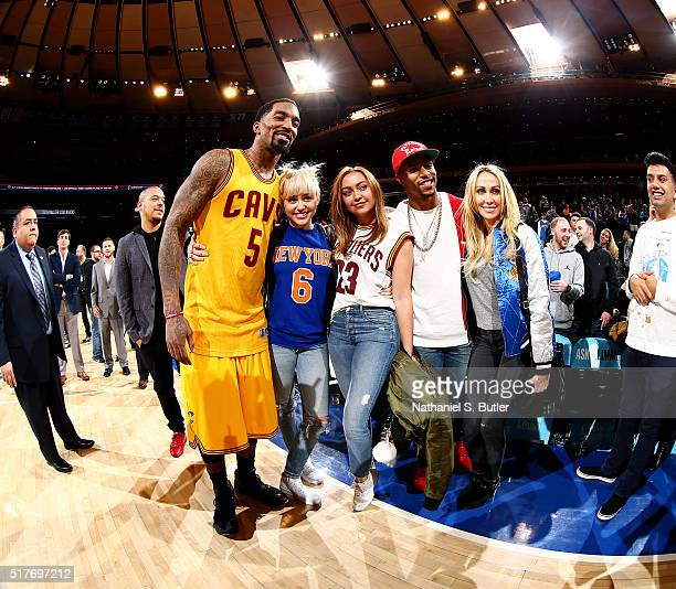 R Smith of the Cleveland Cavaliers is seen with Miley Cyrus and Victor Cruz after the game against the New York Knicks at Madison Square Garden in...
