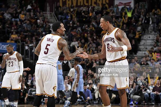 R Smith of the Cleveland Cavaliers shakes hands with Channing Frye of the Cleveland Cavaliers during the game against the Denver Nuggets on March 21...