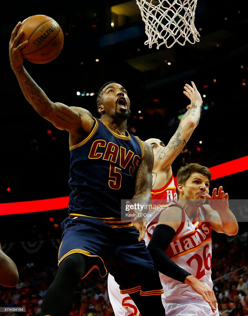 R Smith of the Cleveland Cavaliers shoots against Pero Antic and Kyle Korver of the Atlanta Hawks in the first quarter during Game Two of the Eastern...