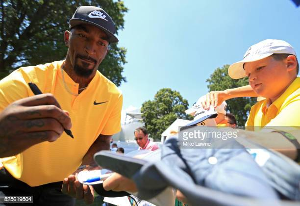 R Smith of the Cleveland Cavaliers signs autographs during a preview day of the World Golf Championships Bridgestone Invitational at Firestone...