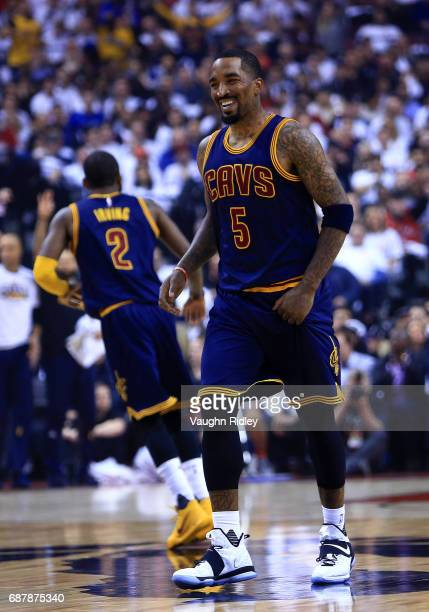 R Smith of the Cleveland Cavaliers smiles in the first half of Game Three of the Eastern Conference Semifinals against the Toronto Raptors during the...