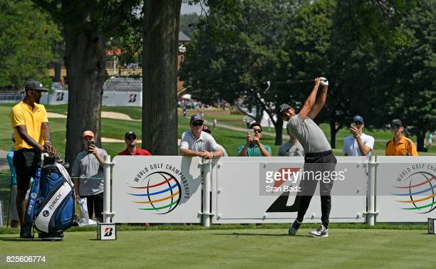 R Smith of the Cleveland Cavaliers spends some time with Jason Day and his caddie Colin Swatton on the course during practice of the World Golf...