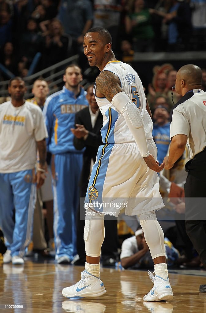 <a gi-track='captionPersonalityLinkClicked' href=/galleries/search?phrase=J.R.+Smith&family=editorial&specificpeople=201766 ng-click='$event.stopPropagation()'>J.R. Smith</a> #5 of the Denver Nuggets celebrates after scoring against the San Antonio Spurs to give the Nuggets their first lead of the game 99-98 in the fourth quarter at the Pepsi Center on March 23, 2011 in Denver, Colorado. The Nuggets defeated the Spurs 115-112.