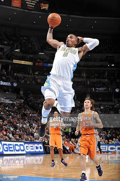 R Smith of the Denver Nuggets goes to the basket against Steve Nash of the Phoenix Suns Hornets on January 11 2011 at the Pepsi Center in Denver...
