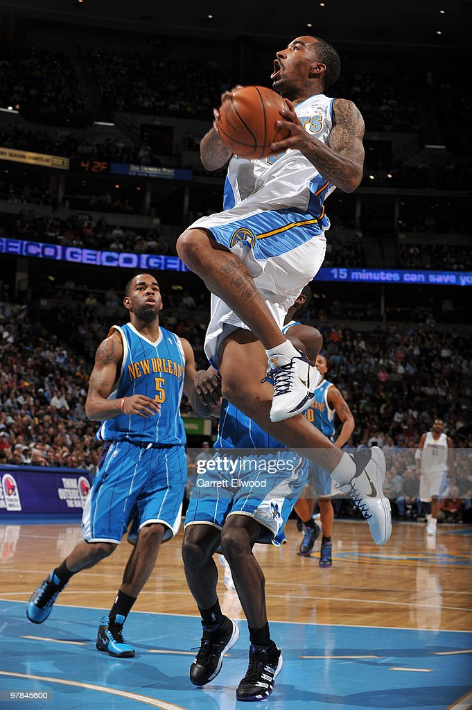 J.R. Smith #5 of the Denver Nuggets goes to the basket against the New Orleans Hornets on March 18, 2010 at the Pepsi Center in Denver, Colorado.