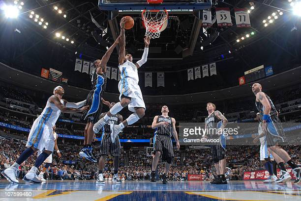 R Smith of the Denver Nuggets goes to the basket against the Orlando Magic on December 14 2010 at the Pepsi Center in Denver Colorado NOTE TO USER...