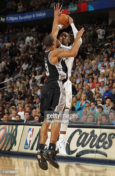 R Smith of the Denver Nuggets takes a shot over George Hill of the San Antonio Spurs to give the Nuggets their first lead of the game 9998 in the...