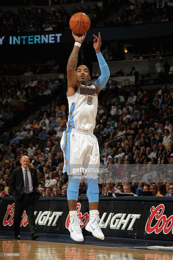 J.R. Smith #5 of the Denver Nuggets takes a three point shot as he had a game high 31 points against the Detroit Pistons as he goes to the basket at the Pepsi Center on March 12, 2011 in Denver, Colorado. The Nuggets defeated the Pistons 131-101.