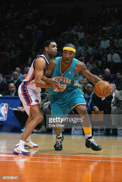 R Smith of the New Orleans Hornets dribbles against Allan Houston of the New York Knicks on January 11 2005 at Madison Square Garden in New York City