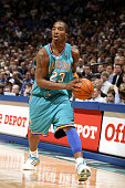 R Smith of the New Orleans Hornets looks to make a pass against the Minnesota Timberwolves during a game on March 23 2005 at the Target Center in...