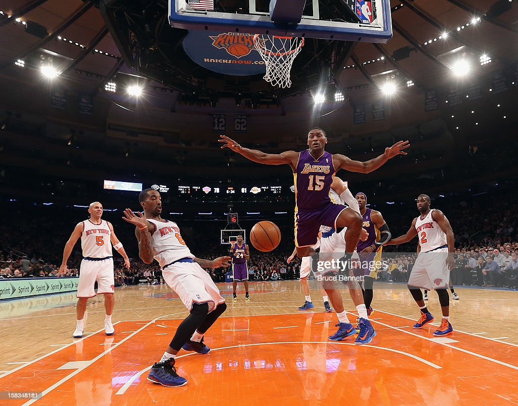 J.R. Smith #8 of the New York Knicks and Metta World Peace #15 of the Los Angeles Lakers battle for a loose ball at Madison Square Garden on December 13, 2012 in New York City.