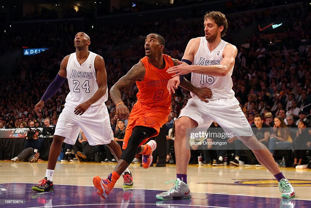 J.R. Smith #8 of the New York Knicks and Pau Gasol #16 of the Los Angeles Lakers vie for position during a free throw during the NBA game at Staples Center on December 25, 2012 in Los Angeles, California. The Lakers defeated the Knicks 100-94.