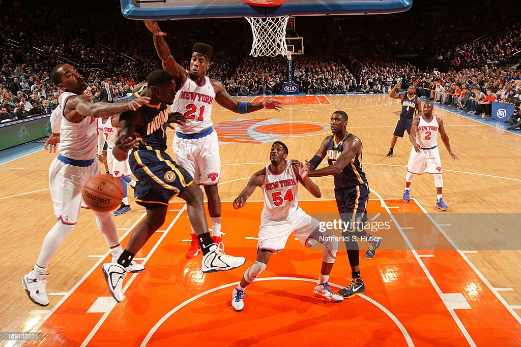 <a gi-track='captionPersonalityLinkClicked' href=/galleries/search?phrase=J.R.+Smith&family=editorial&specificpeople=201766 ng-click='$event.stopPropagation()'>J.R. Smith</a> #8 of the New York Knicks blocks a shot against <a gi-track='captionPersonalityLinkClicked' href=/galleries/search?phrase=Lance+Stephenson&family=editorial&specificpeople=5298304 ng-click='$event.stopPropagation()'>Lance Stephenson</a> #1 of the Indiana Pacers on April 14, 2013 at Madison Square Garden in New York City.