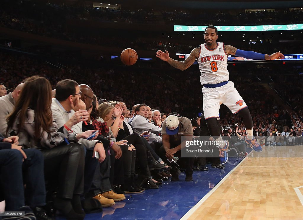 J.R. Smith #8 of the New York Knicks can't keep the ball in bounds during the game against the Indiana Pacers at Madison Square Garden on November 20, 2013 in New York City.