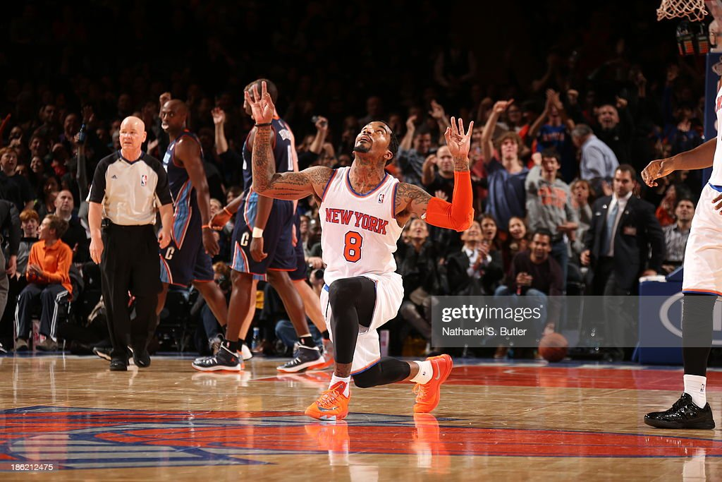 <a gi-track='captionPersonalityLinkClicked' href=/galleries/search?phrase=J.R.+Smith&family=editorial&specificpeople=201766 ng-click='$event.stopPropagation()'>J.R. Smith</a> #8 of the New York Knicks celebrates during a preseason game against the Charlotte Bobcats on October 25, 2013 at Madison Square Garden in New York City.