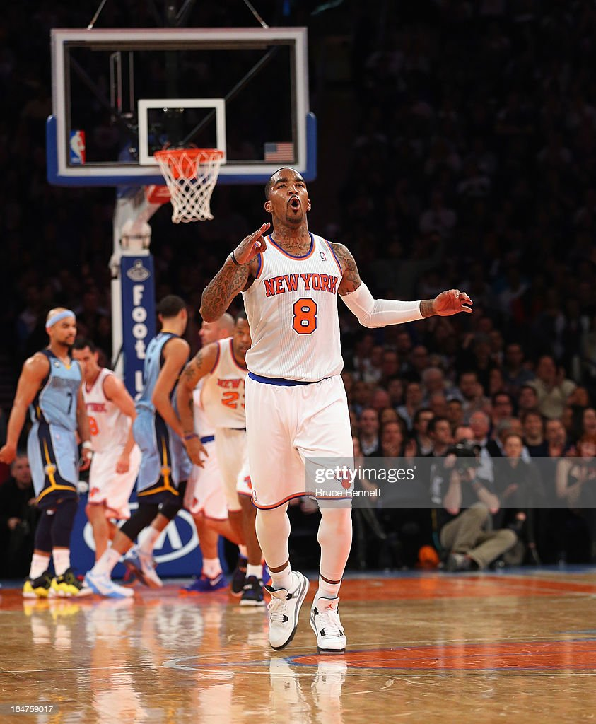 J.R. Smith #8 of the New York Knicks celebrates his three pointer in the second quarter against the Memphis Grizzlies at Madison Square Garden on March 27, 2013 in New York City.