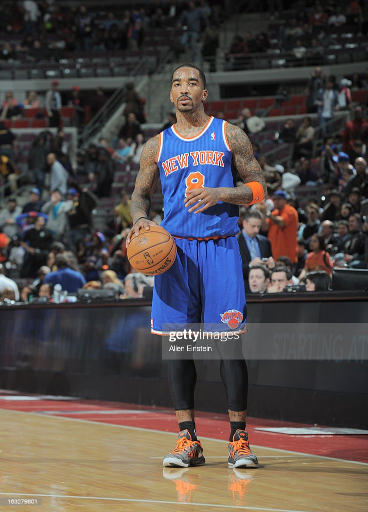 J.R. Smith #8 of the New York Knicks checks the scoreboard during the game between the Detroit Pistons and the Atlanta Hawks on March 6, 2013 at The Palace of Auburn Hills in Auburn Hills, Michigan.