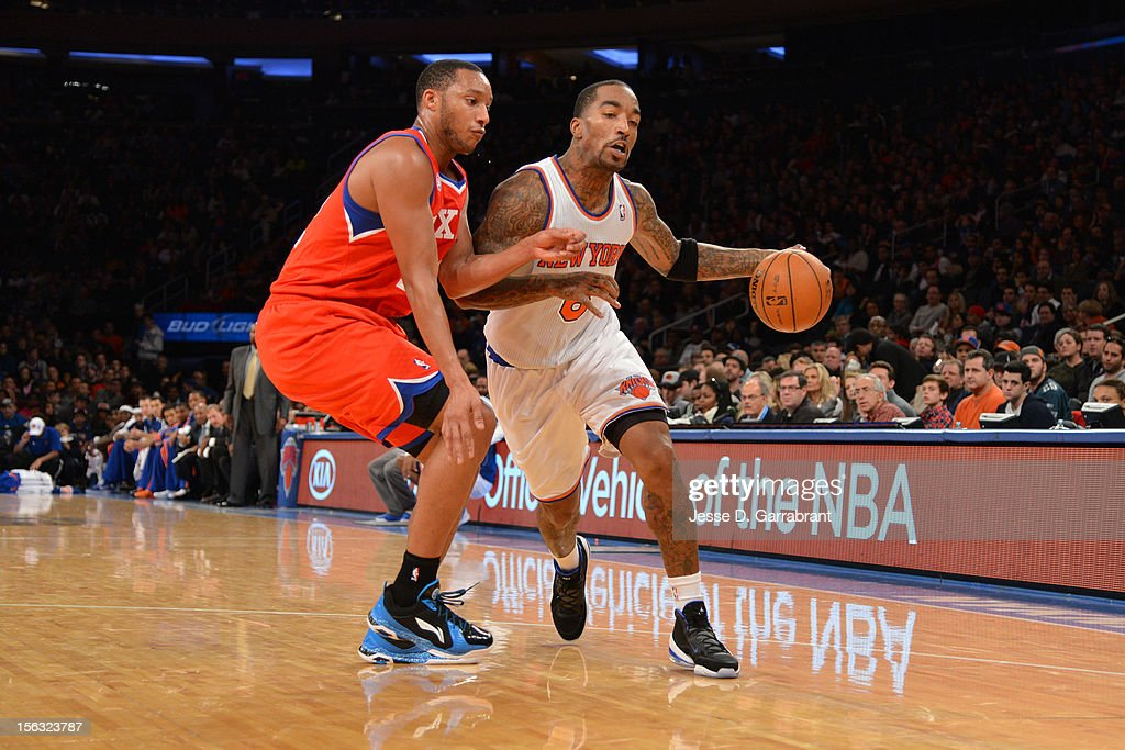 J.R. Smith #8 of the New York Knicks dribbles the ball against Evan Turner #12 of the Philadelphia 76ers on November 4, 2012 at Madison Square Garden in New York City.