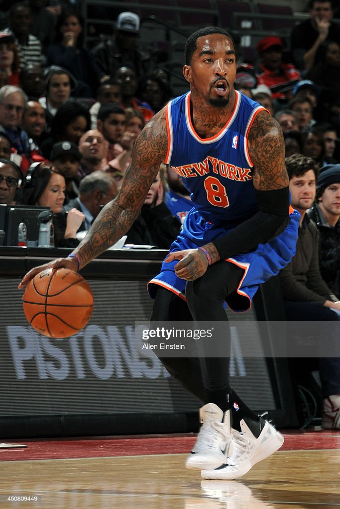 J.R. Smith #8 of the New York Knicks dribbles the ball against the Detroit Pistons on November 19, 2013 at The Palace of Auburn Hills in Auburn Hills, Michigan.