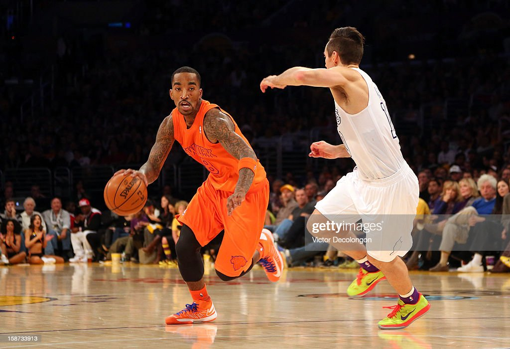 J.R. Smith #8 of the New York Knicks dribbles the ball as Steve Nash #10 of the Los Angeles Lakers keeps pace during the NBA game at Staples Center on December 25, 2012 in Los Angeles, California. The Lakers defeated the Knicks 100-94.