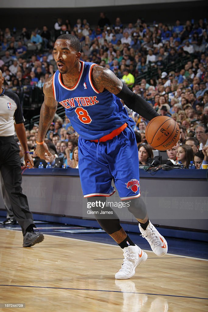 <a gi-track='captionPersonalityLinkClicked' href=/galleries/search?phrase=J.R.+Smith&family=editorial&specificpeople=201766 ng-click='$event.stopPropagation()'>J.R. Smith</a> #8 of the New York Knicks dribbling the ball against the Dallas Mavericks on November 21, 2012 at the American Airlines Center in Dallas, Texas.