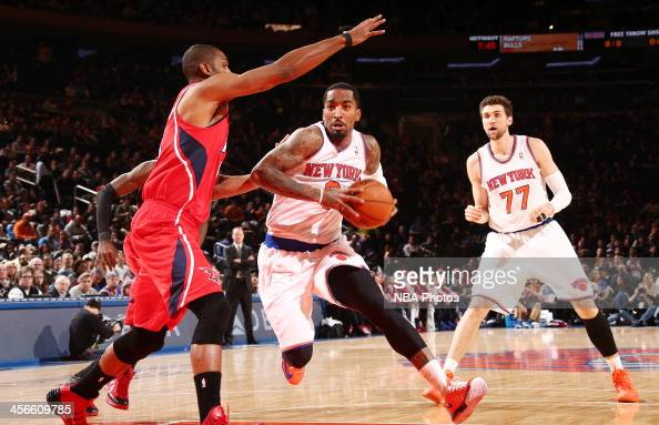 R Smith of the New York Knicks drives against Al Horford of the Atlanta Hawks during a game at Madison Square Garden in New York City NOTE TO USER...