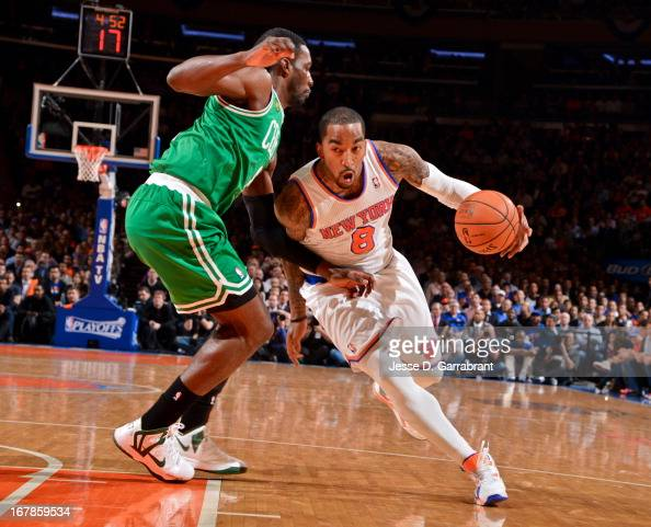 R Smith of the New York Knicks drives against Jeff Green of the Boston Celtics in Game Five of the Eastern Conference Quarterfinals during the 2013...