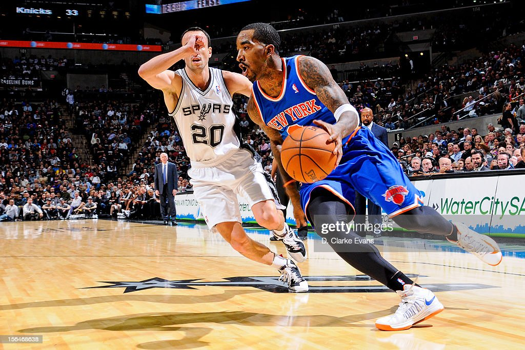 J.R. Smith #8 of the New York Knicks drives against Manu Ginobili #20 of the San Antonio Spurs on November 15, 2012 at the AT&T Center in San Antonio, Texas.