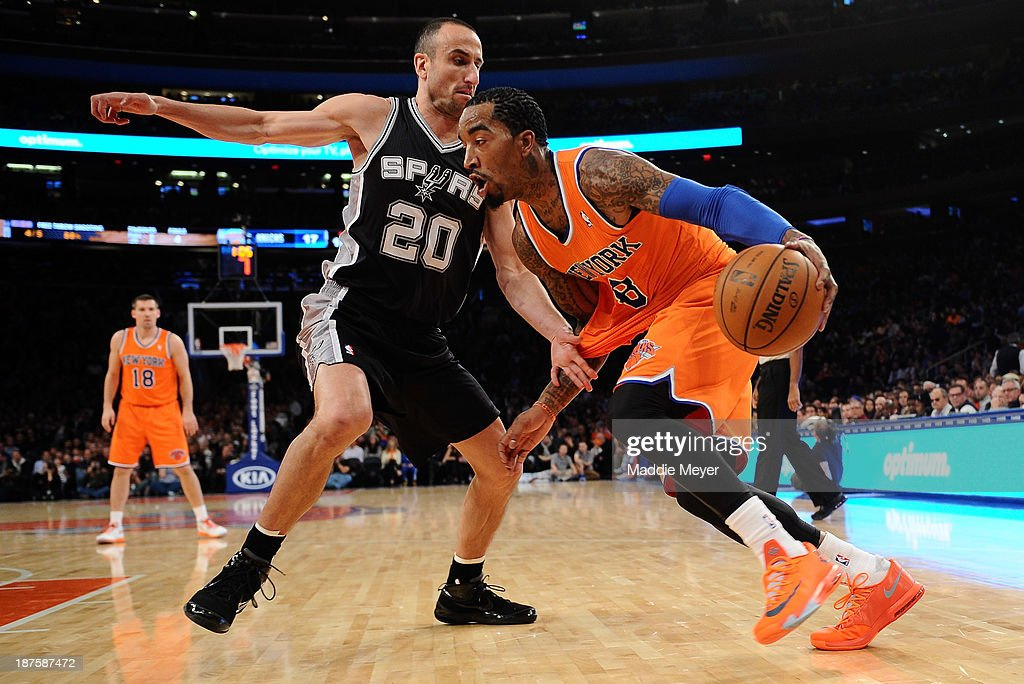 J.R. Smith #8 of the New York Knicks drives against Manu Ginobili #20 of the San Antonio Spurs at Madison Square Garden on November 10, 2013 in New York City. The Spurs defeat the Knicks 120-89.