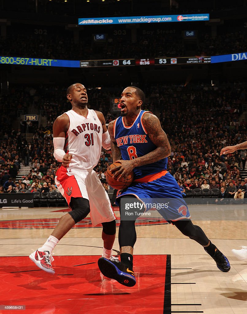 <a gi-track='captionPersonalityLinkClicked' href=/galleries/search?phrase=J.R.+Smith&family=editorial&specificpeople=201766 ng-click='$event.stopPropagation()'>J.R. Smith</a> #8 of the New York Knicks drives against the Toronto Raptors on December 28, 2013 at the Air Canada Centre in Toronto, Ontario, Canada.