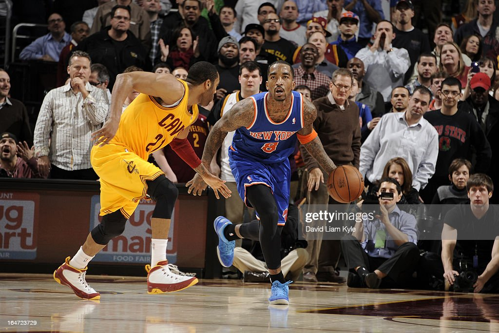 J.R. Smith #8 of the New York Knicks drives against Wayne Ellington #21 of the Cleveland Cavaliers at The Quicken Loans Arena on March 4, 2013 in Cleveland, Ohio.
