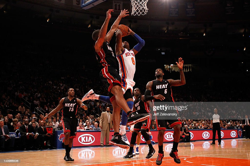 <a gi-track='captionPersonalityLinkClicked' href=/galleries/search?phrase=J.R.+Smith&family=editorial&specificpeople=201766 ng-click='$event.stopPropagation()'>J.R. Smith</a> #8 of the New York Knicks drives for a shot attempt in the first half against Shane Battier #31 and <a gi-track='captionPersonalityLinkClicked' href=/galleries/search?phrase=LeBron+James&family=editorial&specificpeople=201474 ng-click='$event.stopPropagation()'>LeBron James</a> #6 of the Miami Heat in Game Four of the Eastern Conference Quarterfinals in the 2012 NBA Playoffs on May 6, 2012 at Madison Square Garden in New York City.