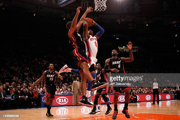 R Smith of the New York Knicks drives for a shot attempt in the first half against Shane Battier and LeBron James of the Miami Heat in Game Four of...