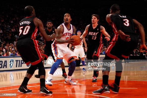 R Smith of the New York Knicks drives in the first half against Joel Anthony LeBron James Mike Miller and Dwyane Wade of the Miami Heat in Game Four...