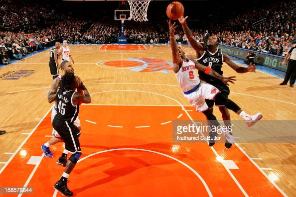 R Smith of the New York Knicks drives to the basket against Andray Blatche of the Brooklyn Nets on December 19 2012 at Madison Square Garden in New...