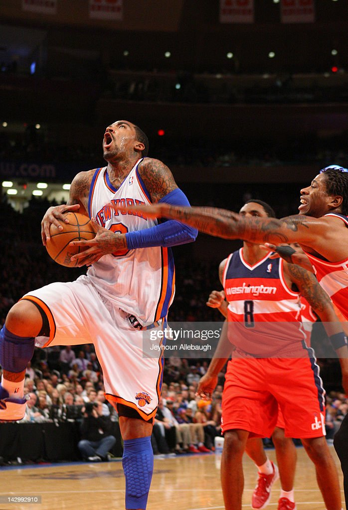 <a gi-track='captionPersonalityLinkClicked' href=/galleries/search?phrase=J.R.+Smith&family=editorial&specificpeople=201766 ng-click='$event.stopPropagation()'>J.R. Smith</a> #8 of the New York Knicks drives to the basket against <a gi-track='captionPersonalityLinkClicked' href=/galleries/search?phrase=Cartier+Martin&family=editorial&specificpeople=834581 ng-click='$event.stopPropagation()'>Cartier Martin</a> #20 of the Washington Wizards during the game on April 13, 2012 at Madison Square Garden in New York City.