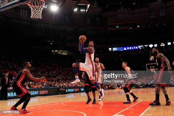 R Smith of the New York Knicks drives to the basket against Dwyane Wade of the Miami Heat at Madison Square Garden on April 15 2012 in New York City...