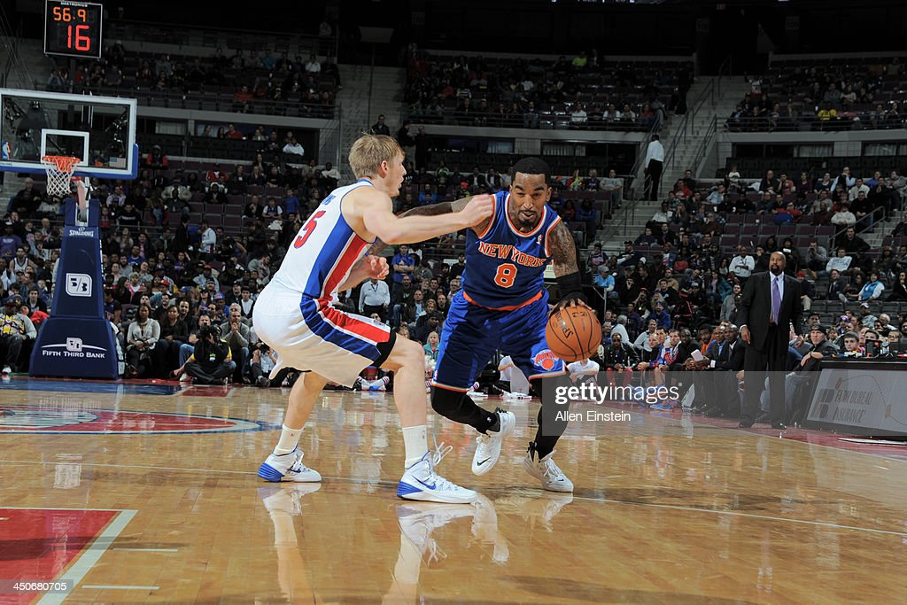 J.R. Smith #8 of the New York Knicks drives to the basket against Kyle Singler #25 of the Detroit Pistons on November 19, 2013 at The Palace of Auburn Hills in Auburn Hills, Michigan.