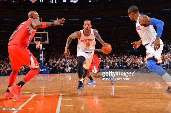 R Smith of the New York Knicks drives to the basket against Lamar Odom of the Los Angeles Clippers during the game at Madison Square Garden on...
