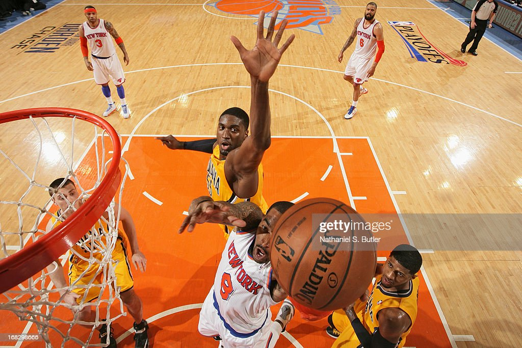 J.R. Smith #8 of the New York Knicks drives to the basket against Roy Hibbert #55 of the Indiana Pacers in Game Two of the Eastern Conference Semifinals during the 2013 NBA Playoffs on May 7, 2013 at Madison Square Garden in New York City.