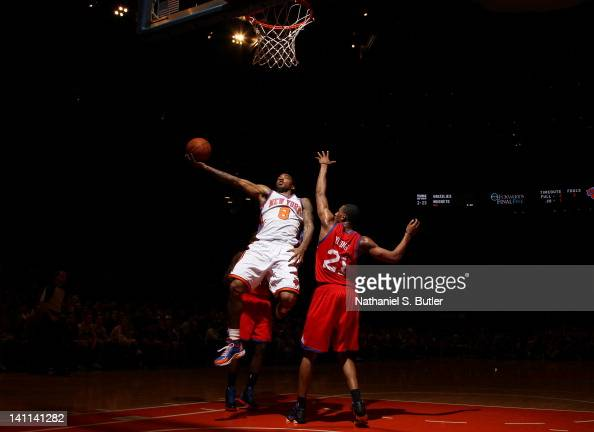 R Smith of the New York Knicks drives to the basket against Thaddeus Young of the Philadelphia 76erson March 11 2012 at Madison Square Garden in New...