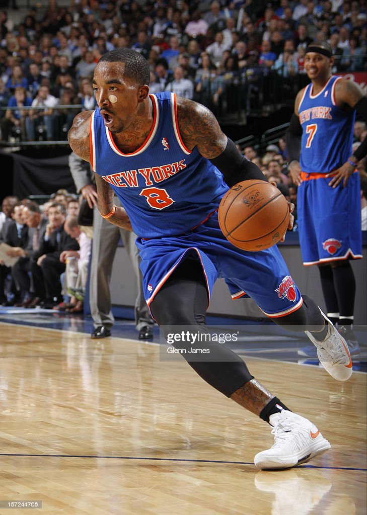 <a gi-track='captionPersonalityLinkClicked' href=/galleries/search?phrase=J.R.+Smith&family=editorial&specificpeople=201766 ng-click='$event.stopPropagation()'>J.R. Smith</a> #8 of the New York Knicks drives to the basket against the Dallas Mavericks on November 21, 2012 at the American Airlines Center in Dallas, Texas.