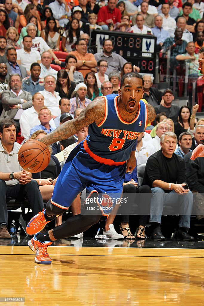 J.R. Smith #8 of the New York Knicks drives to the basket against the Miami Heat on April 2, 2013 at American Airlines Arena in Miami, Florida.