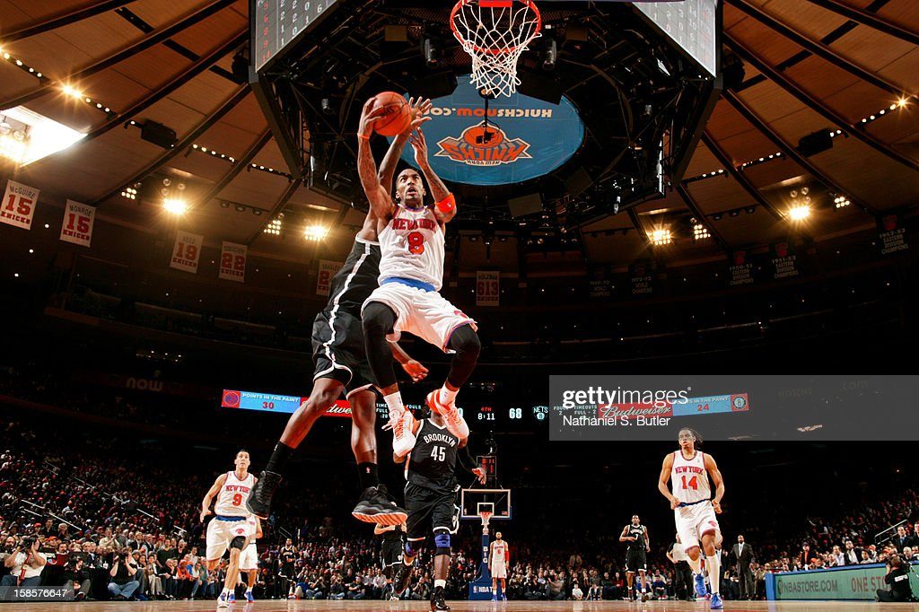 J.R. Smith #8 of the New York Knicks drives to the basket against the Brooklyn Nets on December 19, 2012 at Madison Square Garden in New York City.