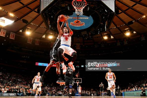 R Smith of the New York Knicks drives to the basket against the Brooklyn Nets on December 19 2012 at Madison Square Garden in New York City NOTE TO...