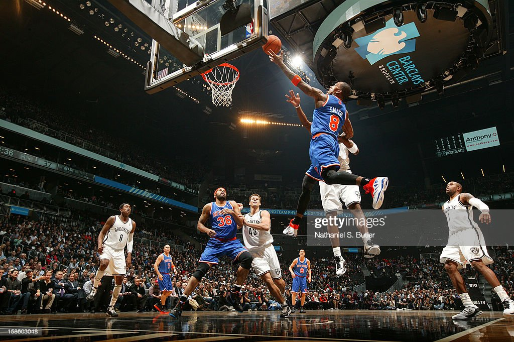J.R. Smith #8 of the New York Knicks drives to the basket against the Brooklyn Nets on December 11, 2012 at the Barclays Center in the Brooklyn borough of New York City.