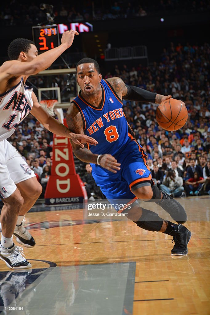 <a gi-track='captionPersonalityLinkClicked' href=/galleries/search?phrase=J.R.+Smith&family=editorial&specificpeople=201766 ng-click='$event.stopPropagation()'>J.R. Smith</a> #8 of the New York Knicks drives to the basket against the New Jersey Nets on April 18, 2012 at the Prudential Center in Newark, New Jersey.