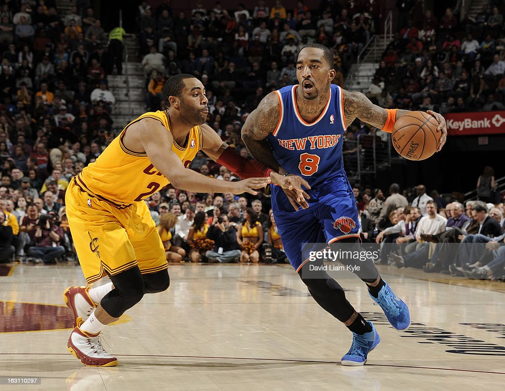 J.R. Smith #8 of the New York Knicks drives to the basket against Wayne Ellington #21 of the Cleveland Cavaliers at The Quicken Loans Arena on March 4, 2013 in Cleveland, Ohio.
