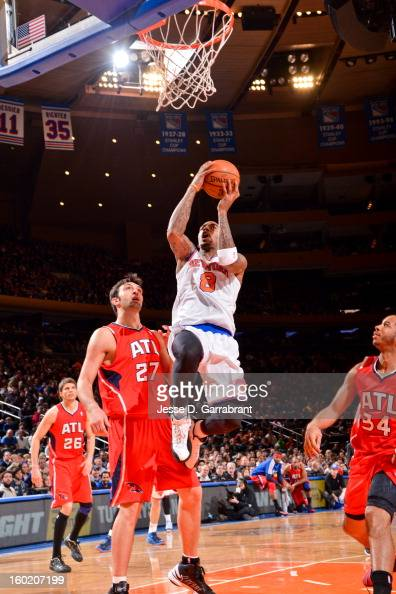 JR Smith of the New York Knicks drives to the basket against Zaza Pachulia of the Atlanta Hawks at Madison Square Garden on January 27 2013 in New...